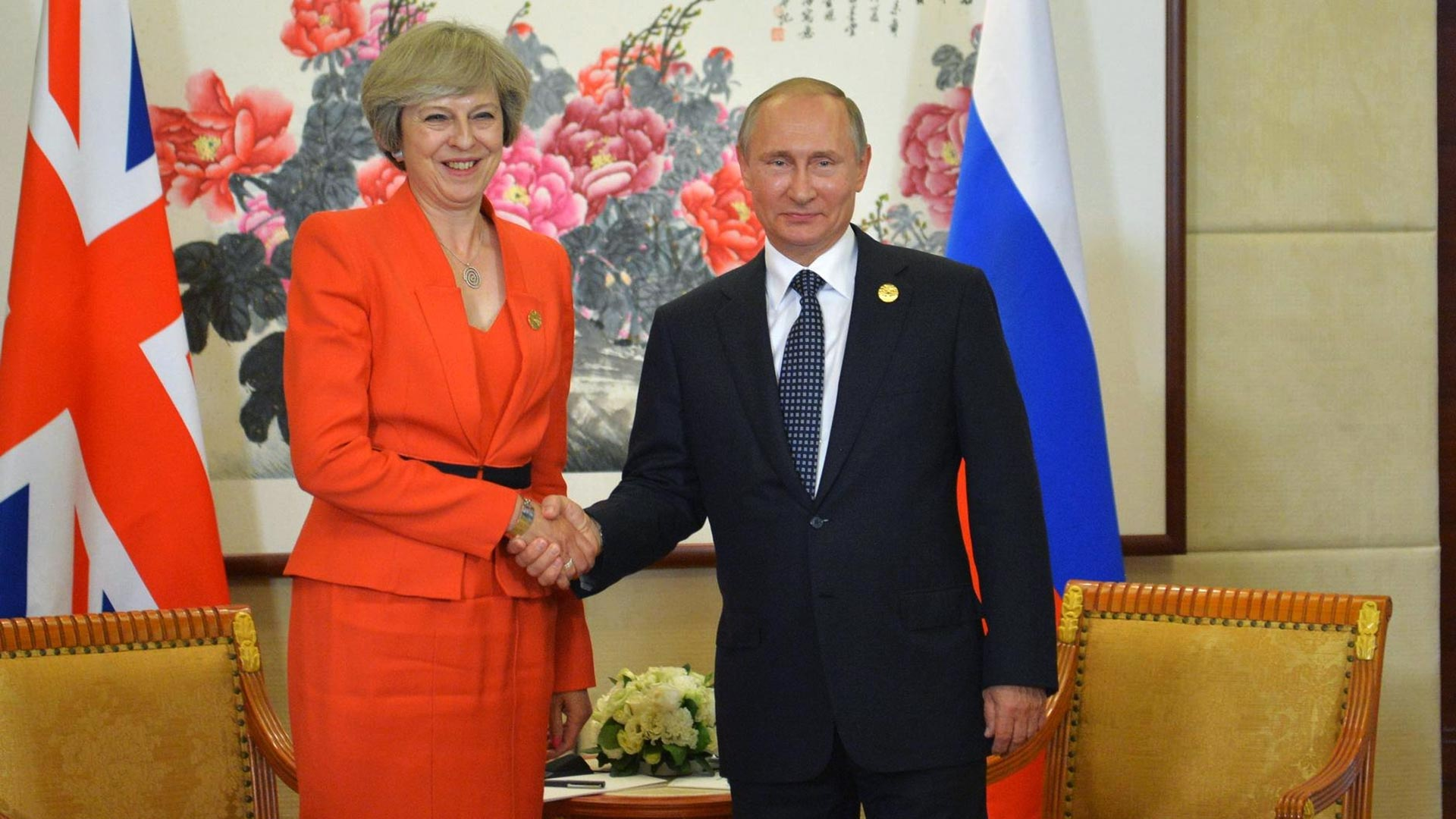Theresa May en Vladimir Poetin